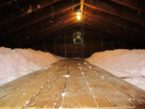 A picture of an attic after insulation