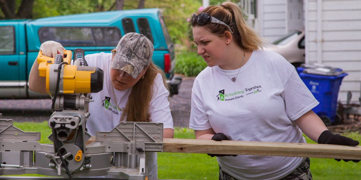 A Group of Volunteers working to repair a home during the Rebuilding Together Howard County National Rebuild Day