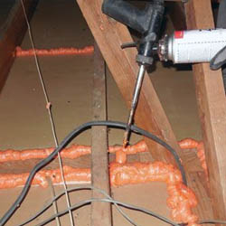 A picture of an attic being air sealed